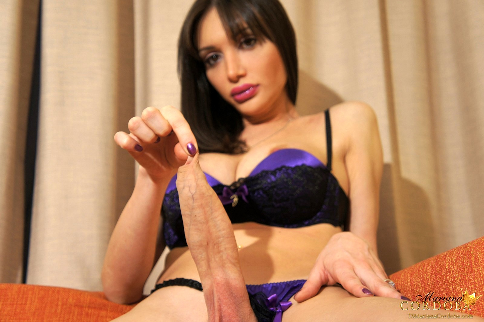 Mariana In Purple Stroking Her Monster Penis
