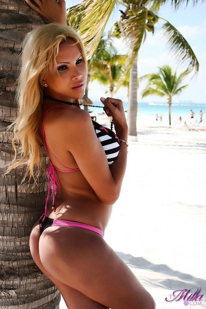 Sensuous Swimsuit Clad TGirl At The Beach